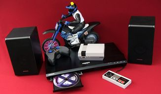 Speakers from Samsung's HW-K950 sound system and UBD-K8500 4K UHD player, Wicked Cool Toys' Xtreme Cycle Moto-Cam and Nintendo's NES Classic Edition. (Photograph by Joseph Szadkowski / The Washington Times)