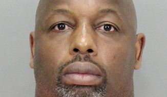 In this undated booking file photo released by the Santa Clara County District Attorney, former NFL football player Dana Stubblefield. Stubblefield, charged with raping a woman described as mentally delayed, appeared in court Friday, June 3, 2016, but did not enter a plea. (Santa Clara County District Attorney via AP, File)