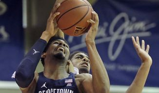 Georgetown guard Rodney Pryor (23) goes to the basket as Oklahoma State forward Lucas N'Guessan, rear, defends during the second half during an NCAA college basketball game in the Maui Invitational on Wednesday, Nov. 23, 2016, in Lahaina, Hawaii. (AP Photo/Rick Bowmer) **FILE**