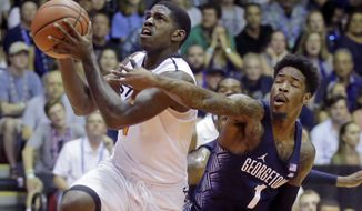 Georgetown guard Tre Campbell (1) defends against Oklahoma State guard Jawun Evans, left, during the first half during an NCAA college basketball game in the Maui Invitational on Wednesday, Nov. 23, 2016, in Lahaina, Hawaii. (AP Photo/Rick Bowmer)