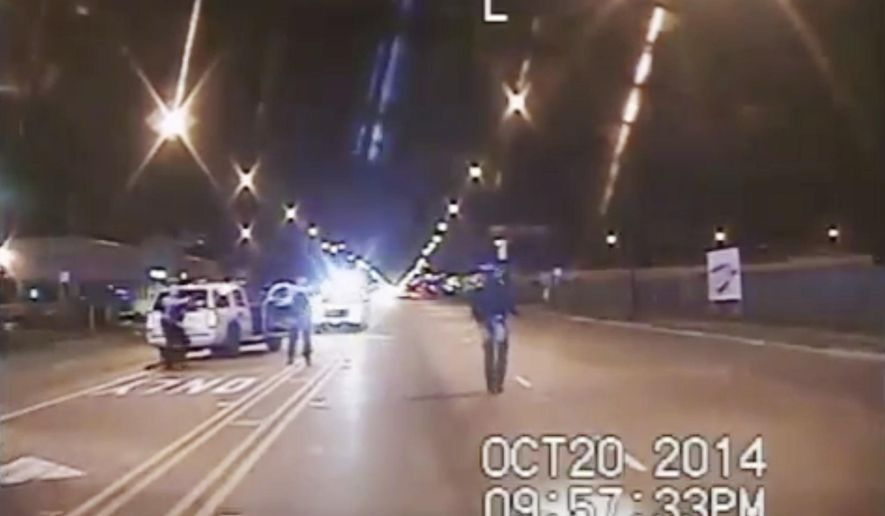 FILE - In this Oct. 20, 2014 frame from dash-cam video provided by the Chicago Police Department, Laquan McDonald, right, walks down the street moments before being fatally shot by CPD officer Jason Van Dyke sixteen times in Chicago. This week marks the one-year anniversary of the release of the video. (Chicago Police Department via AP File)