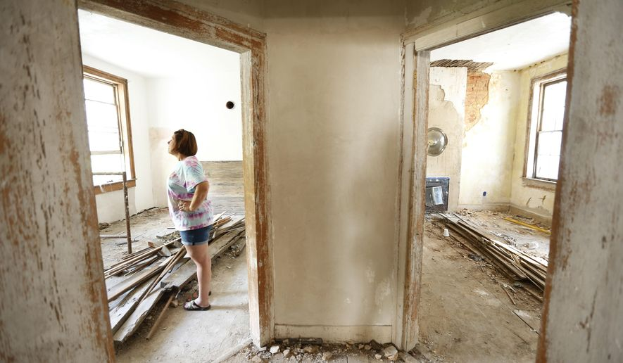 In this Nov. 1, 2016 photo, Genevieve Busby stands inside the Chalmers Institute, in Holy Springs, Miss. Busby and her family have gotten involved in the rehabilitation of the the institute that was built in 1837.  (Thomas Wells/The Northeast Mississippi Daily Journal via AP)