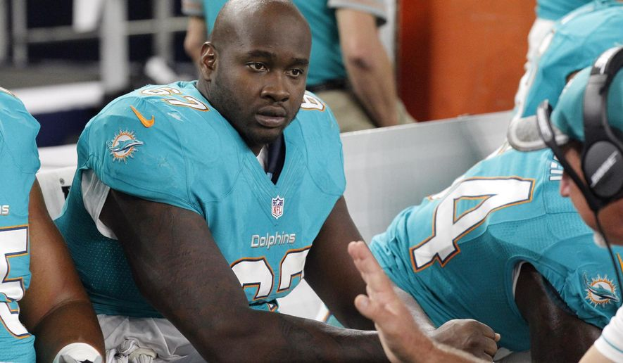 FILE -  In this Friday, Aug. 19, 2016 file photo, Miami Dolphins offensive tackle Laremy Tunsil takes instructions on the sideline in the second half of an NFL preseason football game against the Dallas Cowboys in Arlington, Texas. With three starters hurt, the Miami Dolphins will likely have a patchwork offensive line when they try for their sixth consecutive win Sunday against the 49ers. (AP Photo/Michael Ainsworth, File)
