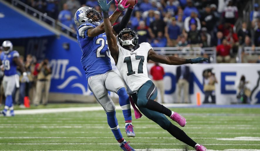 FILE - In this Oct. 9, 2016, file photo, Detroit Lions cornerback Darius Slay (23) intercepts a pass intended for Philadelphia Eagles wide receiver Nelson Agholor (17) in the fourth quarter of an NFL football game, in Detroit. The Detroit Lions hosts the Minnesota Vikings in a matchup of first-place teams in the NFC North on Thanksgiving Day. Slay hopes to help his defense limit receiver Stefon Diggs after he had a career-high 13 receptions in the previous matchup. (AP Photo/Paul Sancya, File)
