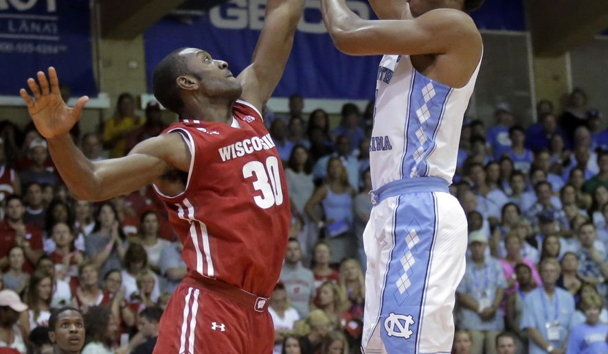 North Carolina forward Isaiah Hicks, right, shoots as Wisconsin forward Vitto Brown (30) defends during the first half during an NCAA college basketball game in the Maui Invitational on Wednesday, Nov. 23, 2016, in Lahaina, Hawaii. (AP Photo/Rick Bowmer)