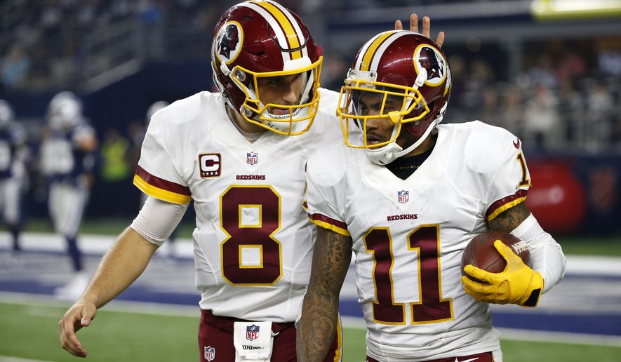 Washington Redskins quarterback Kirk Cousins (8) and wide receiver DeSean Jackson (11) celebrate a touchdown scored by Jackson on a pass from Cousins in the second half of an NFL football game against the Dallas Cowboys on Thursday, Nov. 24, 2016, in Arlington, Texas. (AP Photo/Michael Ainsworth)