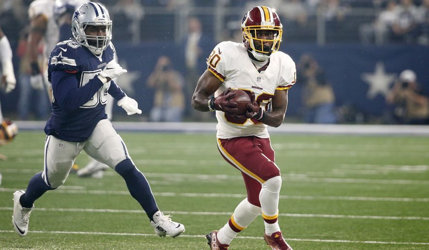 Washington Redskins' Jordan Reed (86) runs the ball gaining yardage after catching a pass in the first half of an NFL football game as Dallas Cowboys' Justin Durant gives chase, Thursday, Nov. 24, 2016, in Arlington, Texas. (AP Photo/Michael Ainsworth)