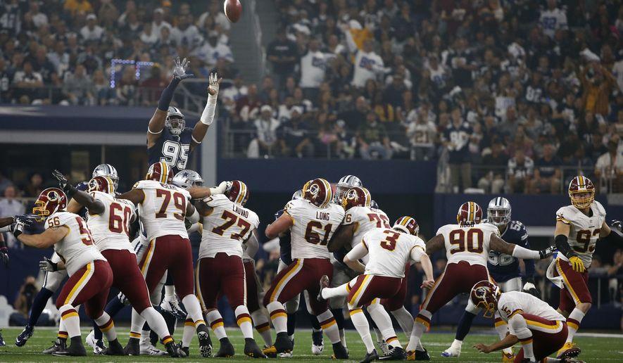 Dallas Cowboys defensive tackle David Irving (95) leaps as Washington Redskins kicker Dustin Hopkins (3) follows through on a failed field goal-attempt in the first half of an NFL football game, Thursday, Nov. 24, 2016, in Arlington, Texas. (AP Photo/Ron Jenkins)