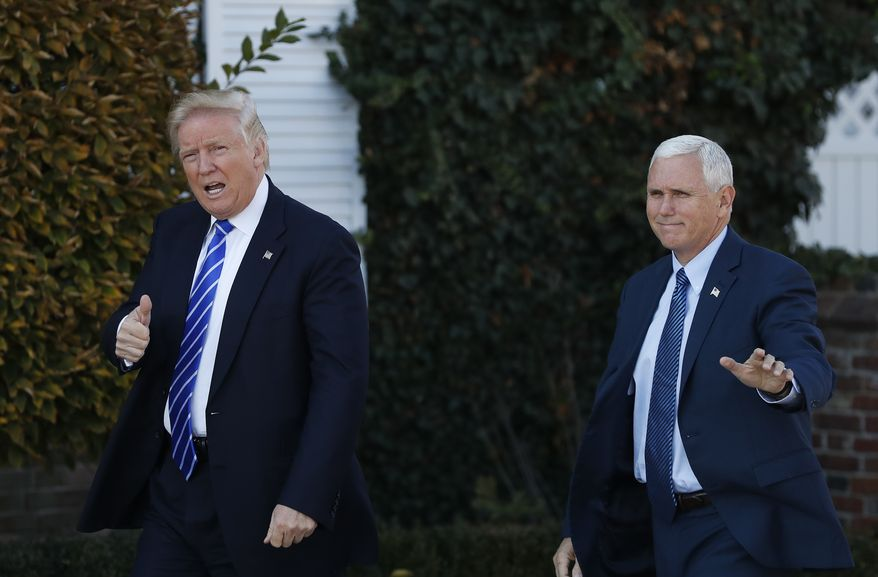 President-elect Donald Trump and Vice President-elect Mike Pence arrive at the Trump National Golf Club Bedminster clubhouse in Bedminster, N.J., Saturday, Nov. 19, 2016. (AP Photo/Carolyn Kaster)