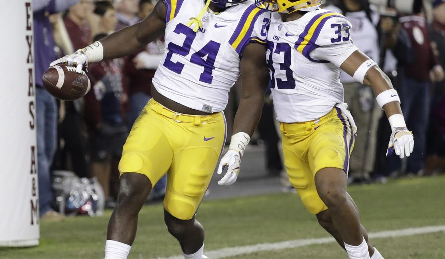 LSU linebacker Devin White (24) celebrates with Jamal Adams (33) after recovering a fumble by Texas A&M during the second quarter of an NCAA college football game Thursday, Nov. 24, 2016, in College Station, Texas. (AP Photo/David J. Phillip)