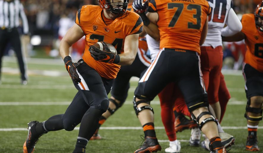 FILE - In this Nov. 19, 2016, file photo, Oregon State running back Ryan Nall runs into the end zone during the second half of an NCAA college football game against Arizona in Corvallis, Ore. Even though there aren't any conference championships or bowl games on the line, the winner of Saturday's Civil War game against Oregon does get something--they avoid the Pac-12 North's basement. (AP Photo/Timothy J. Gonzalez, file)