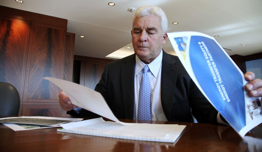In this Friday, Nov. 18, 2016, file photo, Energy Transfer Partners CEO Kelcy Warren reviews documents at his office in Dallas on  the Dakota Access oil pipeline that is mired in controversy after thousand of protestors have sought to block its expansion underneath a water source close to the Standing Rock Sioux Indian Reservation in North Dakota. President-elect Donald Trump holds stock in the company building the disputed Dakota Access oil pipeline, and pipeline opponents warn that Trumps investments could undercut any decision he makes on the $3.8 billion project as president. (AP Photo/ John L. Mone, File)