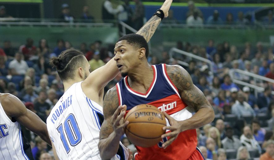 Washington Wizards' Bradley Beal, right, goes to the basket past Orlando Magic's Evan Fournier (10) during the first half of an NBA basketball game, Friday, Nov. 25, 2016, in Orlando, Fla. (AP Photo/John Raoux)