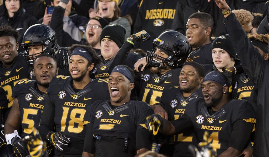 Members of the Missouri football team enter the stands to celebrate their 28-24 victory over Arkansas in an NCAA college football game Friday, Nov. 25, 2016, in Columbia, Mo. AP Photo/L.G. Patterson)