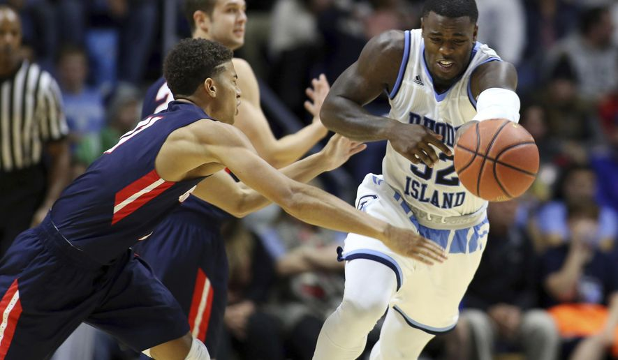 Rhode Island's Jared Terrell (32) is fouled by Belmont's Kevin McClain (11) as he gathers a loose ball during the second half of an NCAA college basketball game in Kingston, R.I., on Friday, Nov. 25, 2016. (AP Photo/Joe Giblin)