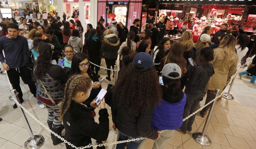 Shoppers queue up in front of Victoria's Secret at the Dartmouth Mall on Black Friday, in Dartmouth, Mass., Nov. 25, 2016.  Stores open their doors Friday for what is still one of the busiest days of the year, even as the start of the holiday season edges ever earlier. (Peter Pereira/Standard Time/SCMGs via AP)