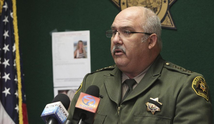 In this Thursday, Nov. 24, 2016 photo, Shasta County, Calif., Sheriff Tom Bosenko addresses the media during a press conference regarding a missing woman who was found, in Yolo County, Calif. Authorities were searching Thursday for two women suspected in the abduction of Sherri Papini a California mother who turned up safe near an interstate three weeks after she disappeared.  (Andreas Fuhrmann  /The Record Searchlight via AP)