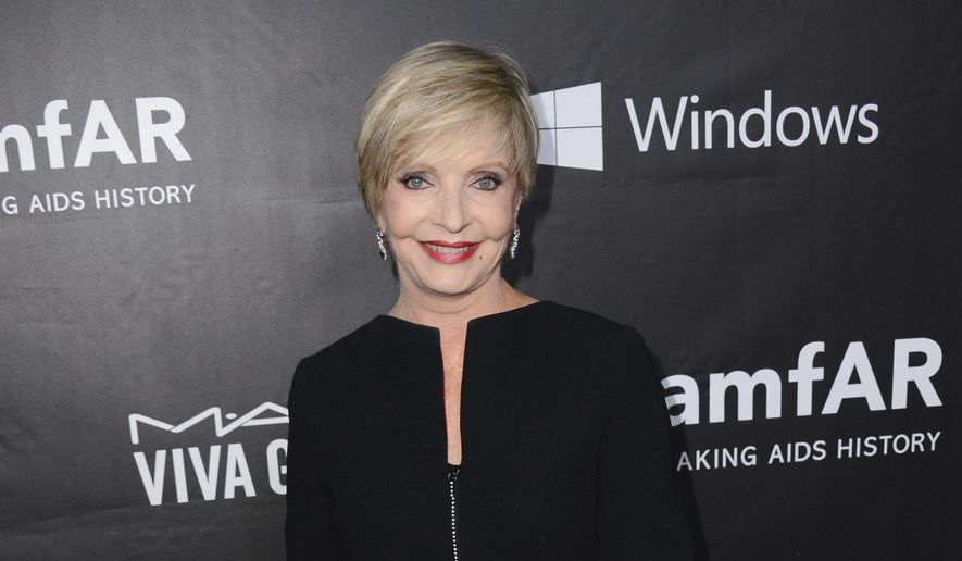 "In this Oct. 29, 2014, file photo, Florence Henderson arrives at the 2014 amfAR Inspiration Gala at Milk Studios in Los Angeles. Henderson, the wholesome actress who went from Broadway star to television icon when she became Carol Brady, the ever-cheerful mom residing over ""The Brady Bunch,"" has died at age 82.  (Photo by Jordan Strauss/Invision/AP, File)"