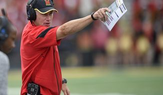 FILE - In this Saturday, Sept. 3, 2016 file photo, Maryland head coach DJ Durkin gestures during the second half of an NCAA football game against Howard in College Park, Md. Maryland still needs one win to earn a bowl bid under first-year coach DJ Durkin. Following an ugly four-game losing streak in which they were outscored 191-49, the Terrapins are left with one final opportunity to snag their elusive sixth victory of the season. (AP Photo/Nick Wass, File)