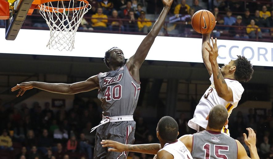 Minnesota's Jordan Murphy, right, beats Southern Illinois' Thik Bol to a rebound during the first half of an NCAA college basketball game Friday, Nov. 25, 2016, in Minneapolis. (AP Photo/Jim Mone)