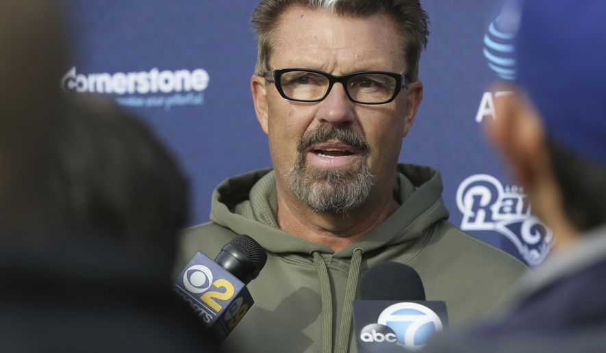 FILE - In a Friday Oct. 21, 2016 file photo, Los Angeles Rams defensive coordinator Gregg Williams speaks to the media after a practice session at Pennyhill Park Hotel in Bagshot, England. When the New Orleans Saints host the Rams on Sunday, Nov. 27, Williams and New Orleans coach Sean Payton will coach in the same game for the first time since Payton fired Williams after the 2011 season. (AP Photo/Tim Ireland, File)