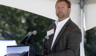 FILE - This Monday, Aug. 24, 2015 file photo U.S. Sen. Dean Heller, R-Nev., speaks at the 19th Annual Lake Tahoe Summit at Zephyr Cove, in South Lake Tahoe, Nev. The women's rights group UltraViolet ran a full-page ad in the Reno Gazette-Journal this week accusing Heller of doing nothing when president-elect Donald Trump named Steve Bannon as chief White House strategist. .The group acknowledges Heller can't directly block Trump's adviser choice, but says he could refuse to approve other Trump nominees until Trump boots Bannon. (AP Photo/Rich Pedroncelli, File)