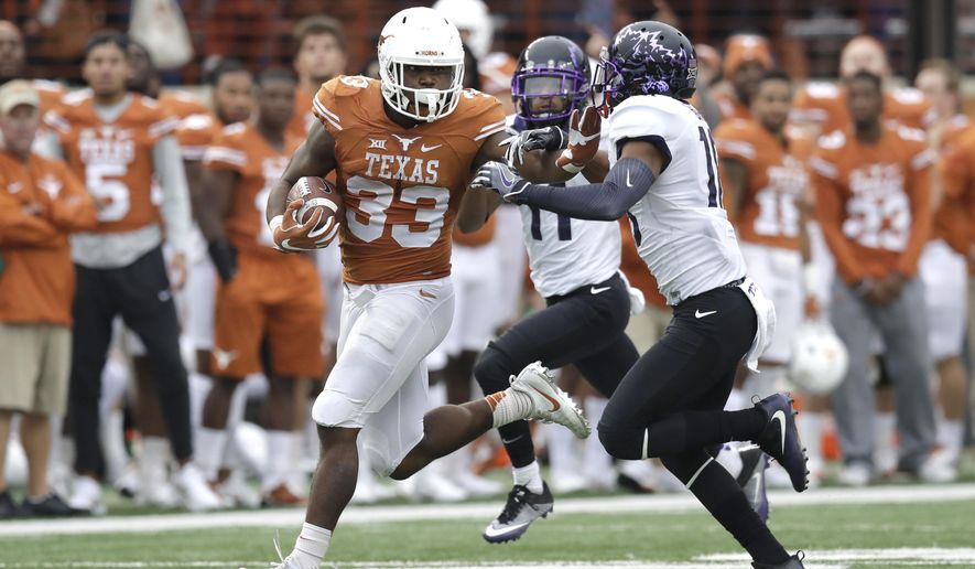 Texas running back D'Onta Foreman (33) is pursued by TCU safety Nick Orr (18) on a 44-yard carry during the second half of an NCAA college football game, Friday, Nov. 25, 2016, in Austin, Texas. (AP Photo/Eric Gay)