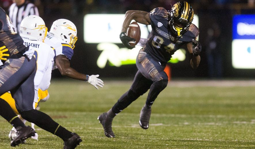 Western Michigan wide receiver Corey Davis (84) runs with the ball against Toledo during an NCAA college football game Friday, Nov. 25, 2016, in Kalamazoo, Mich. (Bryan Bennett/Kalamazoo Gazette-MLive Media Group via AP)