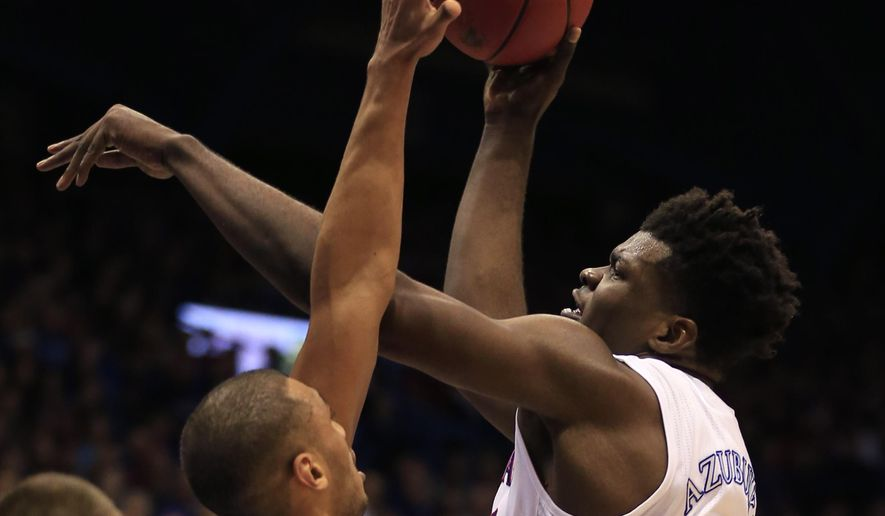 Kansas center Udoka Azubuike (35) shoots over UNC-Asheville forward Will Weeks during the first half of an NCAA college basketball game in Lawrence, Kan., Friday, Nov. 25, 2016. (AP Photo/Orlin Wagner)