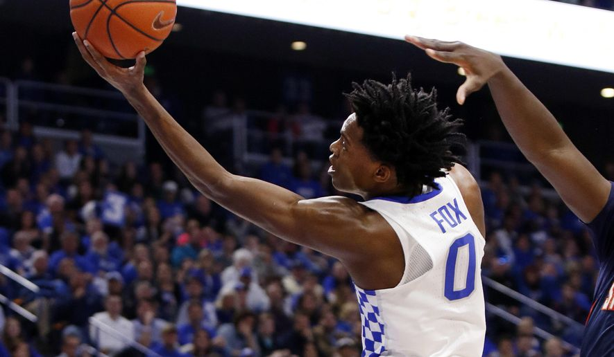 Kentucky's De'Aaron Fox (0) shoots near the defense of Tennessee-Martin's Mike Fofana during the first half of an NCAA college basketball game, Friday, Nov. 25, 2016, in Lexington, Ky. (AP Photo/James Crisp)