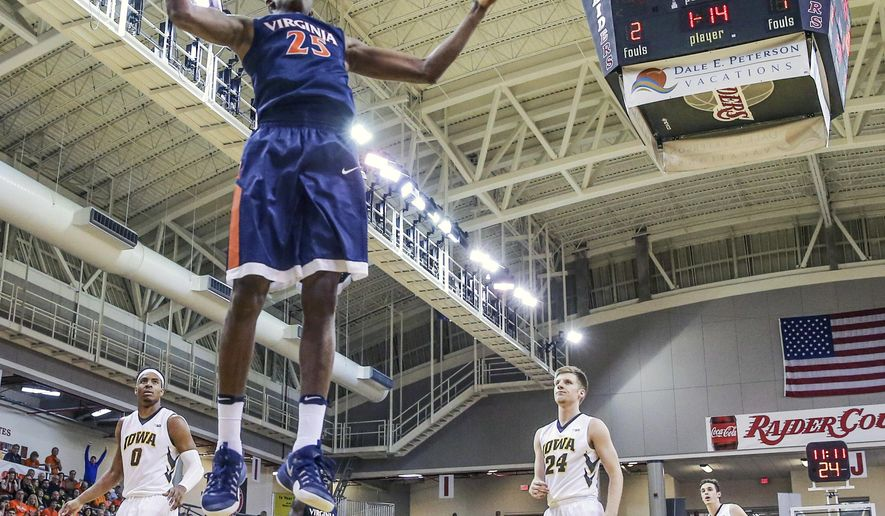 Virginia forward Mamadi Diakite (25) dunks the ball during the first half of an NCAA college basketball game against Iowa at the Emerald Coast Classic in Niceville, Fla., Friday, Nov. 25, 2016. (AP Photo/Gary McCullough)