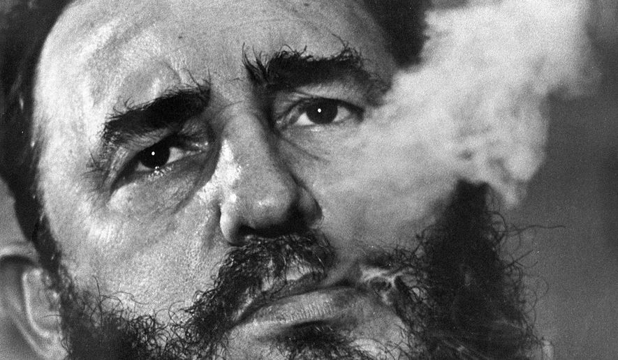 In this March 1985 file photo, Cuba's leader Fidel Castro exhales cigar smoke during an interview at the presidential palace in Havana, Cuba. Castro has died at age 90. President Raul Castro said on state television that his older brother died late Friday, Nov. 25, 2016. (AP Photo/Charles Tasnadi, File)