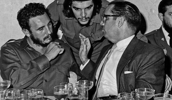 "In this 1960 photo, Cuba's revolutionary hero Ernesto ""Che"" Guevara, center, Cuba's leader Fidel Castro, left, and Cuba's President Osvaldo Dorticos, right, attend a reception in an unknown location in Cuba. Former President Fidel Castro, who led a rebel army to improbable victory in Cuba, embraced Soviet-style communism and defied the power of 10 U.S. presidents during his half century rule, has died at age 90. The bearded revolutionary, who survived a crippling U.S. trade embargo as well as dozens, possibly hundreds, of assassination plots, died eight years after ill health forced him to formally hand power over to his younger brother Raul, who announced his death late Friday, Nov. 25, 2016, on state television. (Prensa Latina via AP Images, File)"