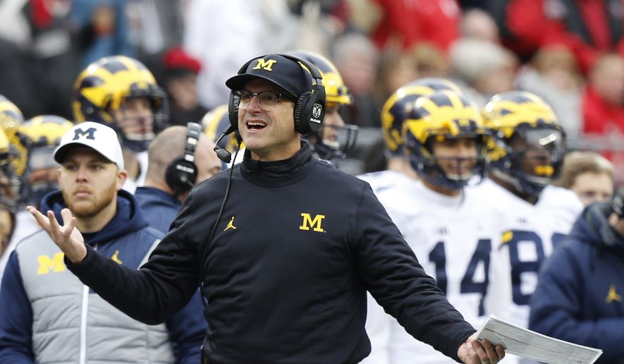 Michigan head coach Jim Harbaugh walks the sidelines during the second half of an NCAA college football game Saturday, Nov. 26, 2016, in Columbus, Ohio. Ohio State beat Michigan 30-27 in double overtime. (AP Photo/Jay LaPrete) **FILE**