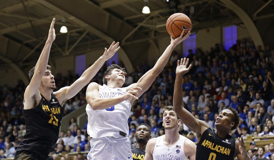 Duke's Grayson Allen drives to the basket against Appalachian State's Jake Wilson (15) and Isaac Johnson (0) as Duke's Antonio Vrankovic (30) watches during the first half of an NCAA college basketball game in Durham, N.C., Saturday, Nov. 26, 2016. (AP Photo/Gerry Broome)