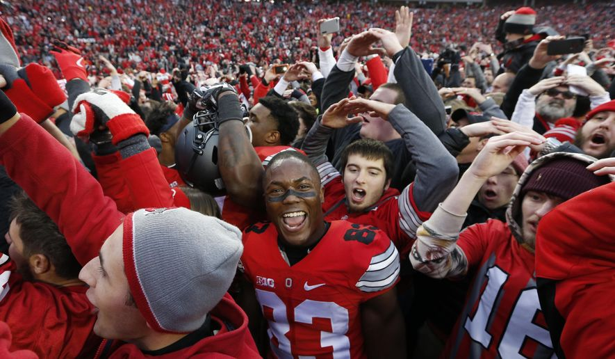 Ohio State players and fans celebrate their win over Michigan in an NCAA college football game Saturday, Nov. 26, 2016, in Columbus, Ohio. Ohio State beat Michigan 30-27 in double overtime. (AP Photo/Jay LaPrete)