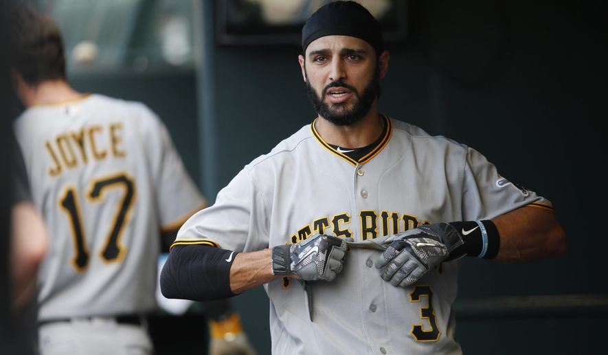 FILE - Int his June 9, 2016 photo, Pittsburgh Pirates' Sean Rodriguez pulls off his batting gloves after striking out against Colorado Rockies during the ninth inning of a baseball game in Denver. A person familiar with the situation says the Atlanta Braves have agreed to an $11.5 million, two-year contract with utility player Sean Rodriguez.The person spoke on condition of anonymity to The Associated Press on on Saturday, Nov. 26, 2016,  because the agreement will not become official until Rodriguez passes a physical. (AP Photo/David Zalubowski, File)