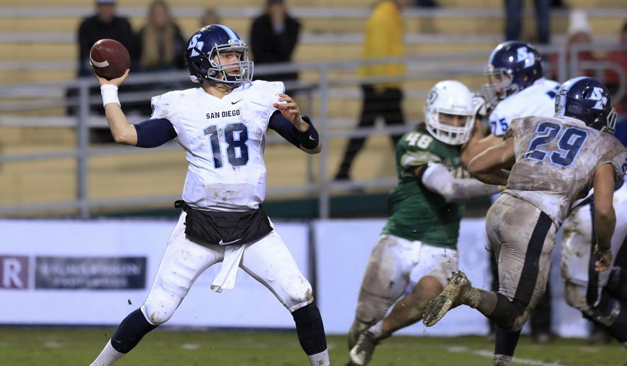 San Diego quarterback Anthony Lawrence (18) looks for a receiver during the second quarter against Cal Poly in an NCAA FCS first-round playoff game Saturday, Nov. 26, 2016, in San Luis Obispo, Calif. (Laura Dickinson/The Tribune (of San Luis Obispo) via AP)