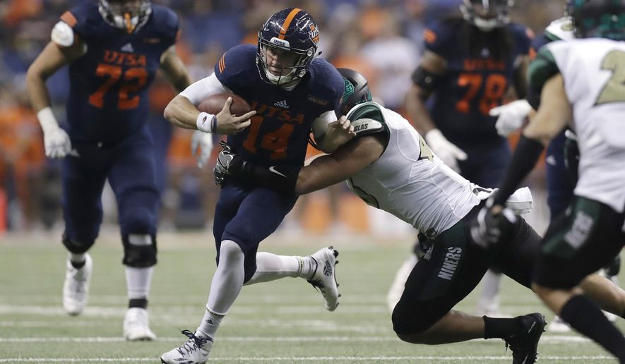 UTSA quarterback Dalton Sturm (14) is hit by Charlotte linebacker Alex Highsmith (46) during the second half of an NCAA college football game, Saturday, Nov. 26, 2016, in San Antonio. (AP Photo/Eric Gay)