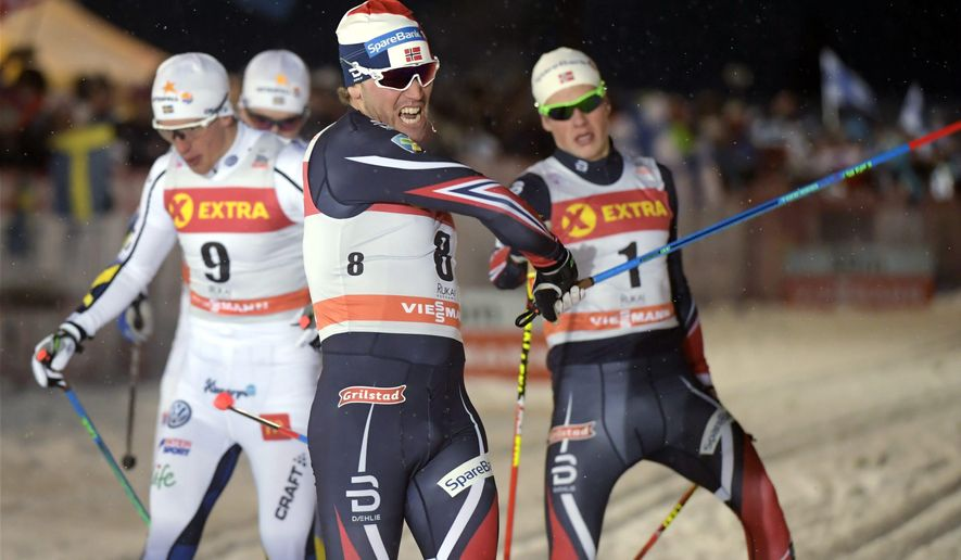 Winner Paal Golberg of Norway, centre, celebrates winning the men's Sprint Classic final at FIS Ruka Nordic 2016 World Cup season opening in Kuusamo, Finland, on Saturday Nov. 26, 2016. 2nd placed Calle Halfvarsson of Sweden is on the left and 3rd placed Johannes Hoesflot Klaebo of Norway, right. (Markku Ulander/Lehtikuva via AP)