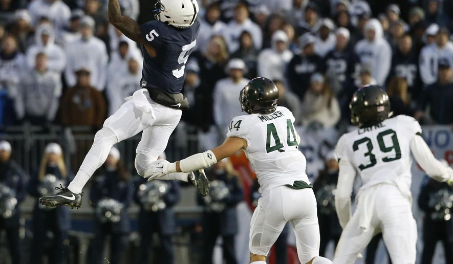 Penn State's DaeSean Hamilton (5) makes a catch in front of Michigan State's Grayson Miller (44) during the first half of an NCAA college football game in State College, Pa., Saturday Nov. 26, 2016. (AP Photo/Chris Knight)