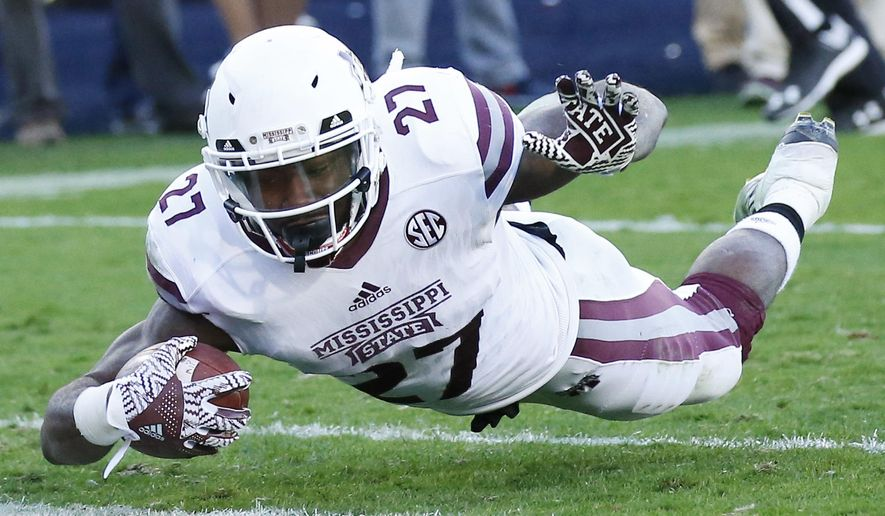 Mississippi State running back Aeris Williams (27) dives into the end zone to cap a 16-yard touchdown run in the first half of an NCAA college football game against Mississippi in Oxford, Miss., Saturday, Nov. 26, 2016. (AP Photo/Rogelio V. Solis)