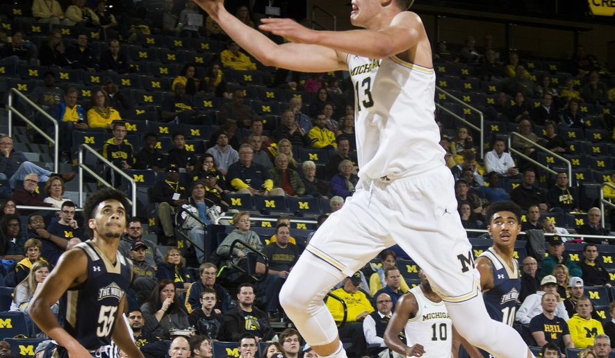 Michigan forward Moritz Wagner (13), of Germany, goes for a layup in the first half of an NCAA college basketball game against Mount St. Mary's at Crisler Center in Ann Arbor, Mich., Saturday, Nov. 26, 2016. (AP Photo/Tony Ding)