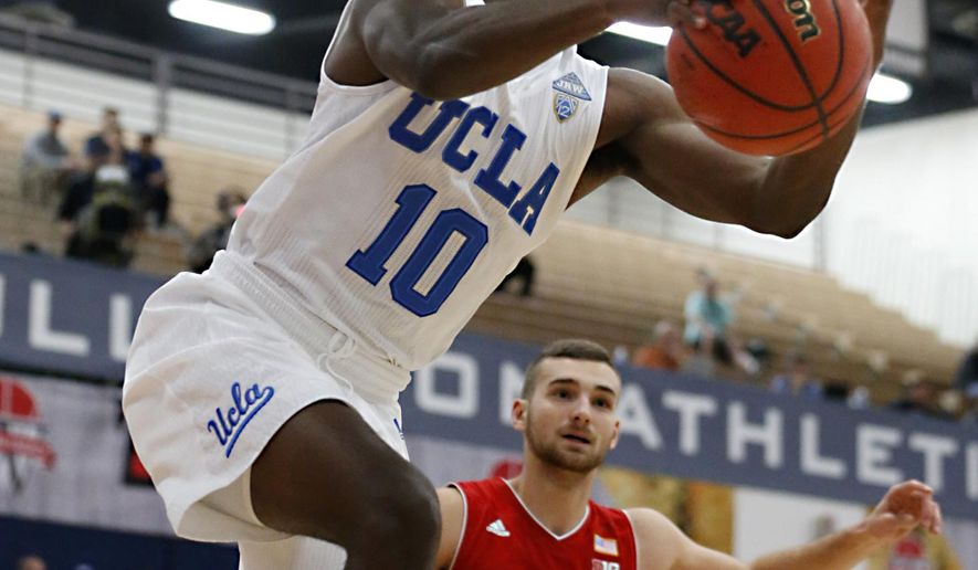 UCLA's Isaac Hamilton (10) reaches for the the ball during the first half of an NCAA college basketball game against Nebraska at the Wooden Legacy tournament Friday, Nov. 25, 2016, in Fullerton, Calif. (AP Photo/Christine Cotter)