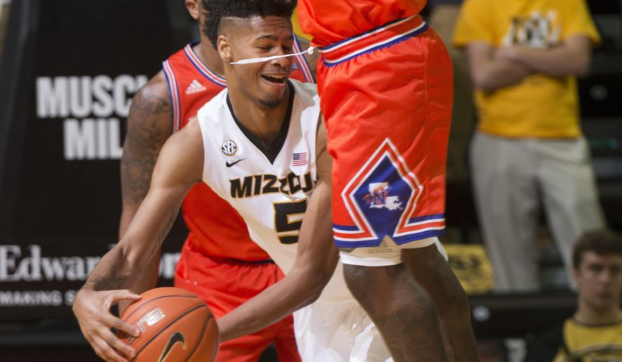 Missouri's Mitchell Smith, left, tries to pass the ball around Northwestern State's Zeek Woodley, right, during the second half of an NCAA college basketball game Saturday, Nov. 26, 2016, in Columbia, Mo. Missouri won the game 84-60. (AP Photo/L.G. Patterson)