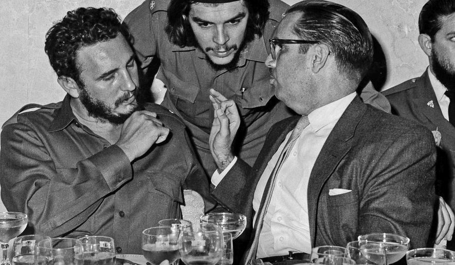 "FILE - In this 1960 file photo, Cuba's revolutionary hero Ernesto ""Che"" Guevara, center, Cuba's leader Fidel Castro, left, and Cuba's President Osvaldo Dorticos, right, attend a reception in an unknown location in Cuba. Castro has died at age 90. President Raul Castro said on state television that his older brother died at 10:29 p.m. Friday, Nov. 25, 2016. (AP Photo/Prensa Latina via AP Images, File)"