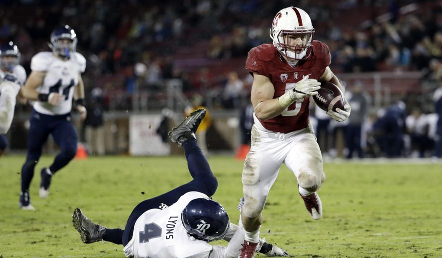 Stanford running back Christian McCaffrey, right, runs past Rice linebacker Alex Lyons (4) on a 23-yard touchdown reception during the first half of an NCAA college football game Saturday, Nov. 26, 2016, in Stanford, Calif. (AP Photo/Marcio Jose Sanchez)