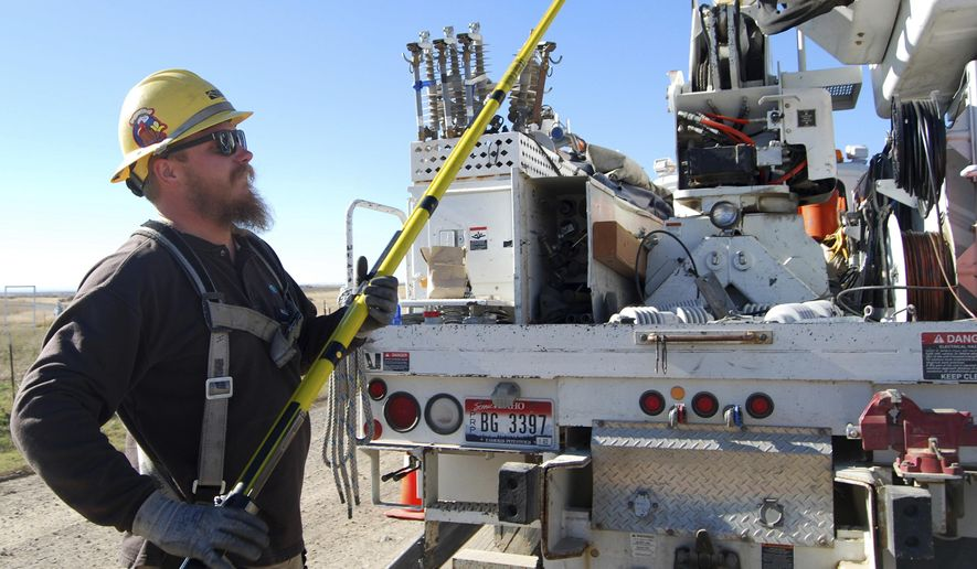 In this Nov. 11, 2016 photo, Idaho Power Co. apprentice lineman Claysen Hale prepares to do maintenance in Eden, Idaho. The company's apprenticeship programs, implemented in 1954, have helped to address the need for skilled employees, decrease turnover and replace retired workers. (Heather Kennison/Times-News via AP)