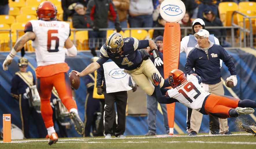 Pittsburgh quarterback Nathan Peterman (4) dives in for a touchdown past Syracuse defensive back Daivon Ellison (19) during the first half of an NCAA college football game in Pittsburgh, Saturday, Nov. 26, 2016.(AP Photo/Jared Wickerham)