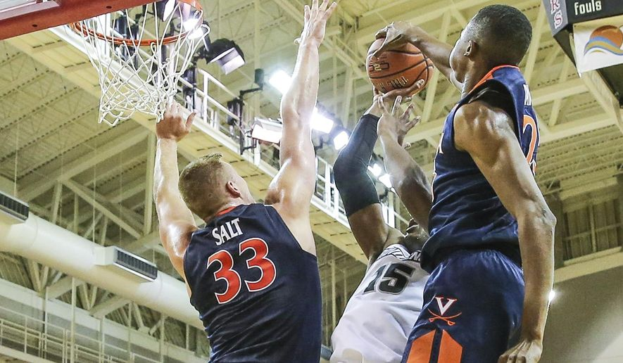 Shot by Providence forward Emmitt Holt (15) is blocked by Virginia forward Mamadi Diakite (25), right, and center Jack Salt (33) during the second half of an NCAA college basketball game at the Emerald Coast Classic in Niceville, Fla., Saturday, Nov. 26, 2016. Virginia won 63-52. (AP Photo/Gary McCullough)
